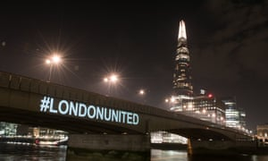London Bridge is lit up with the words #LondonUnited.