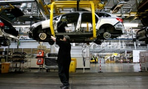 A worker on the production line of General Motors' Vauxhall plant in Ellesmere Port in Cheshire.