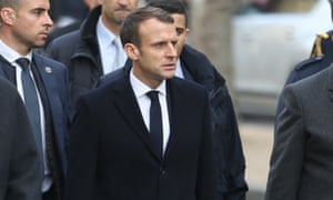Emmanuel Macron inspects the damage after violent clashes in Paris