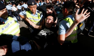 Pro-democracy activist Avery Ng is detained by Hong Kong police as he takes part in a protest demanding the release of Chinese Nobel rights activist Liu Xiaobo.