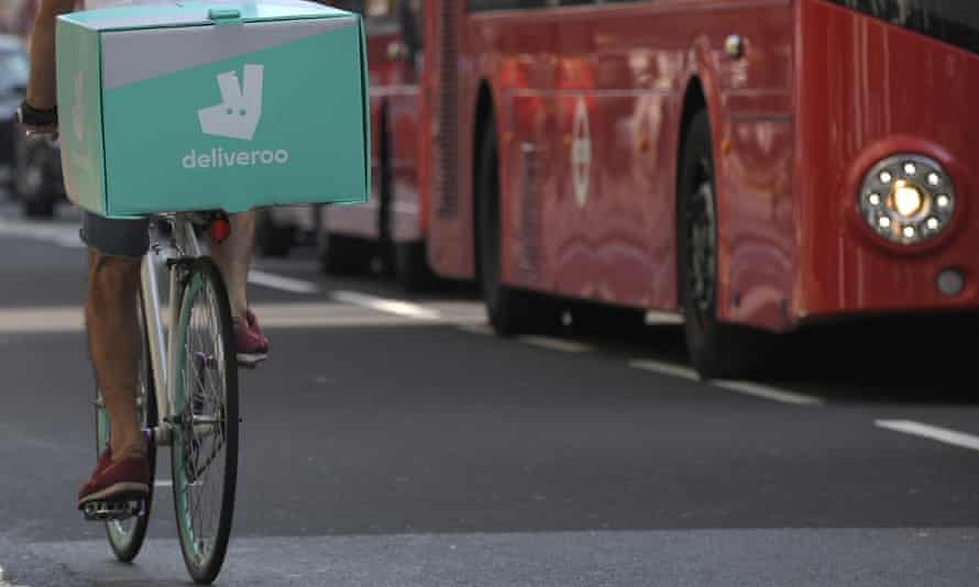 A cyclist delivers food for Deliveroo in London