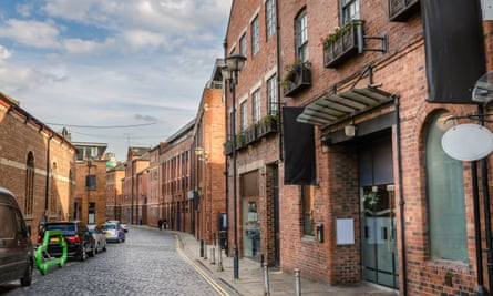 Exterior of 43 the Calls, cobbled Street  Lined with Renovated Brick Buildings