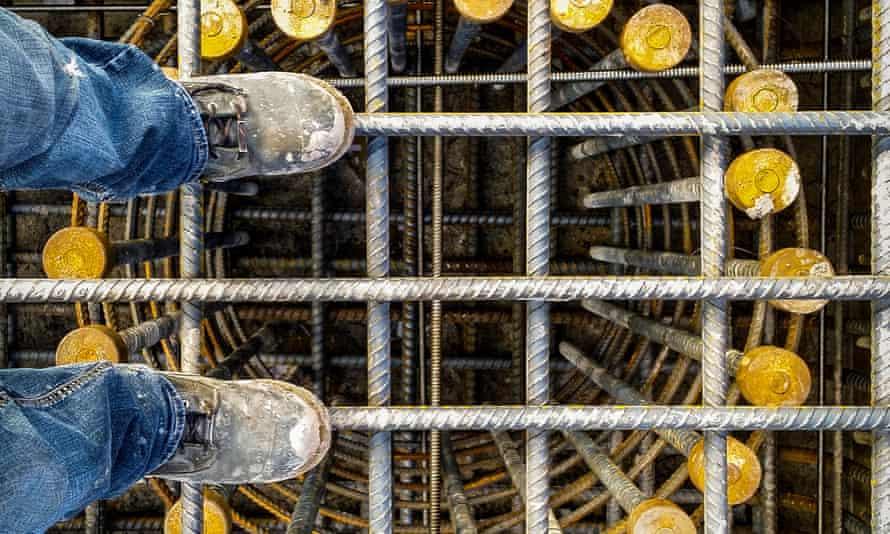 Heavy civil construction, reinforced concrete cage for bridge footing. Civil Construction Worker, Boots On Concrete Bridge, Reinforcing Steel Cage