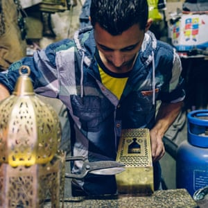 One of Mohammed Hani's sons at work on a lantern