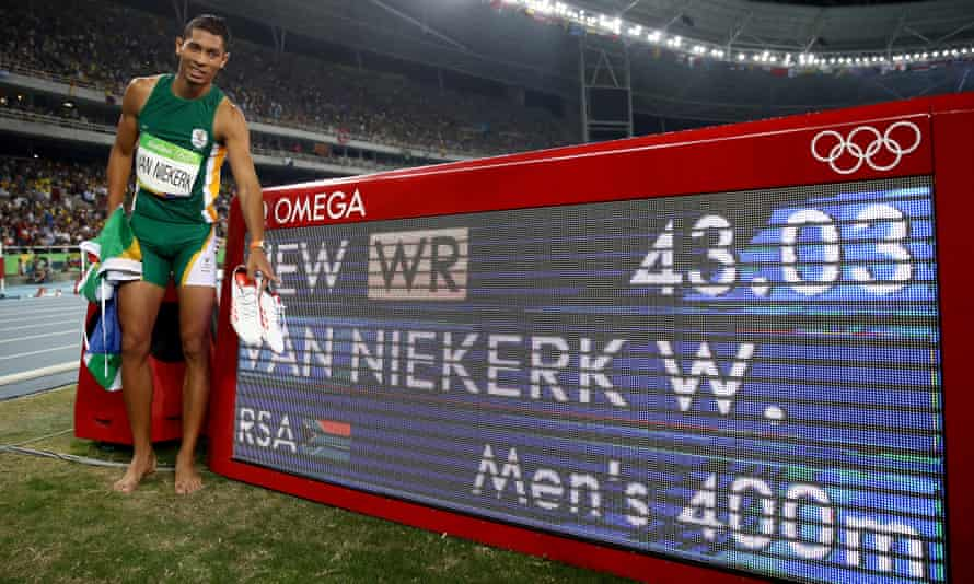 Wayde van Niekerk of South Africa celebrates after setting a new world record to win the men's 400m.