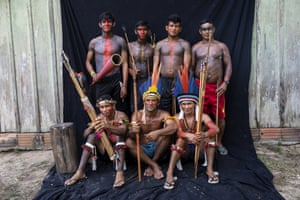 Tembe warriors pose for a portrait during a meeting of Tembe tribes in the Tekohaw village, in the Alto Rio Guama Indigenous Reserve, in Brazil's Para state