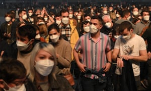 Spectators wait for the start of a rock music concert by Spanish group Love of Lesbian at the Palau Sant Jordi in Barcelona. Attendees underwent Covid-19 Rapid Antigen Tests and are required to wear face masks but the social distancing rule will not be complied as part of a study on virus propagation.