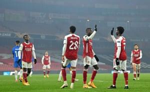 Nicolas Pepe celebrates scoring with Bukayo Saka.