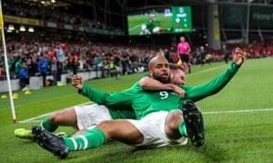 Ireland's David McGoldrick celebrates scoring a goal with Alan Judge.