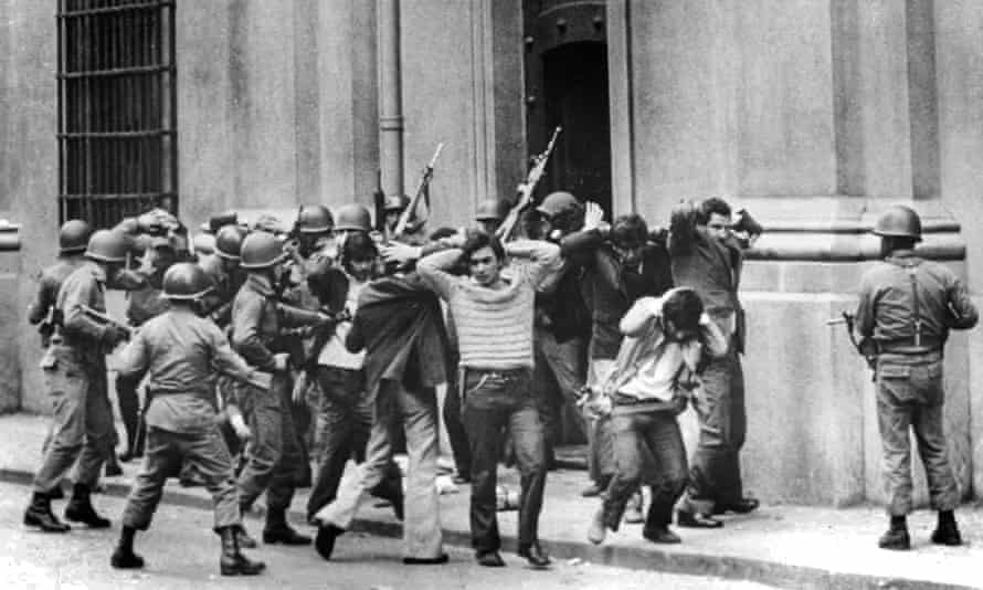 Staff of Chilean president Salvador Allende are held by soldiers outside the presidential palace during the coup d'etat on 11 September 1973.