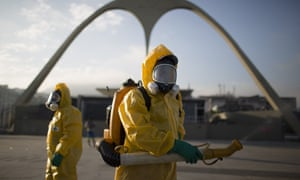Workers spray insecticide to combat the mosquito species that transmits the Zika virus in Brazil. Gene drive technology could help tackle the problem.