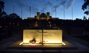 Dawn breaks over the Australian War Memorial and the Stone of Remembrance during the dawn service at the Australian War Memorial in Canberra.
