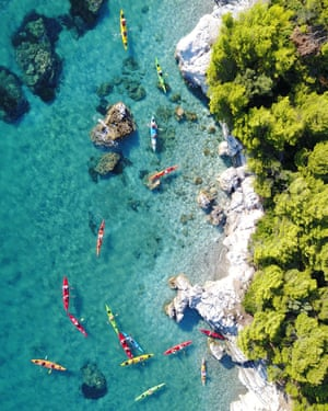 Drone image of kayaks at Skopelos Kastani Beach. A great way to explore Skopelos is by kayak, which means access to deserted beaches, sea caves and uninhabited islands. Often you can spot local marine life including dolphins, monk seals and turtles in the emerald green waters off the coast.