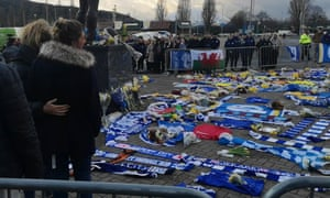 Emiliano Sala's sister Romina Sala (second left) and her cousin Maria Sottini look at tributes to the footballer outside Cardiff City's stadium