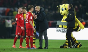 Then Bayern manager Pep Guardiola talks to Joshua Kimmich at the final whistle in Dortmund in 2016
