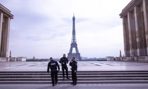 Police in front of the Eiffel Tower.
