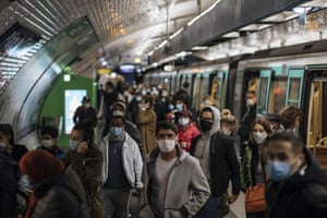 Commuters wearing face masks walk on the platform, of a Paris subway, Sunday, 25 October, 2020. A curfew, intended to curb the spiraling spread of the coronavirus, has been imposed in many regions of France including Paris and its suburbs.