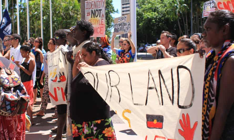 Protesters listen to Labor senator Nova Peris at the #sosblakaustralia rally outside parliament house in Darwin on May 1, 2015 demonstrating against possible closures of Aboriginal communities in Western Australia.