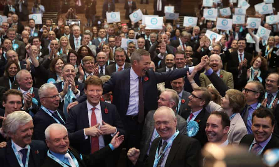 Brexit party candidates pose with Farage and the party chairman, Richard Tice