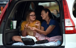 People eat in their car while waiting for the show to start at the Ocala Drive-in