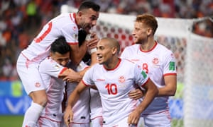 Wahbi Khazri, second right, celebrates with teammates after scoring Tunisia's second goal.