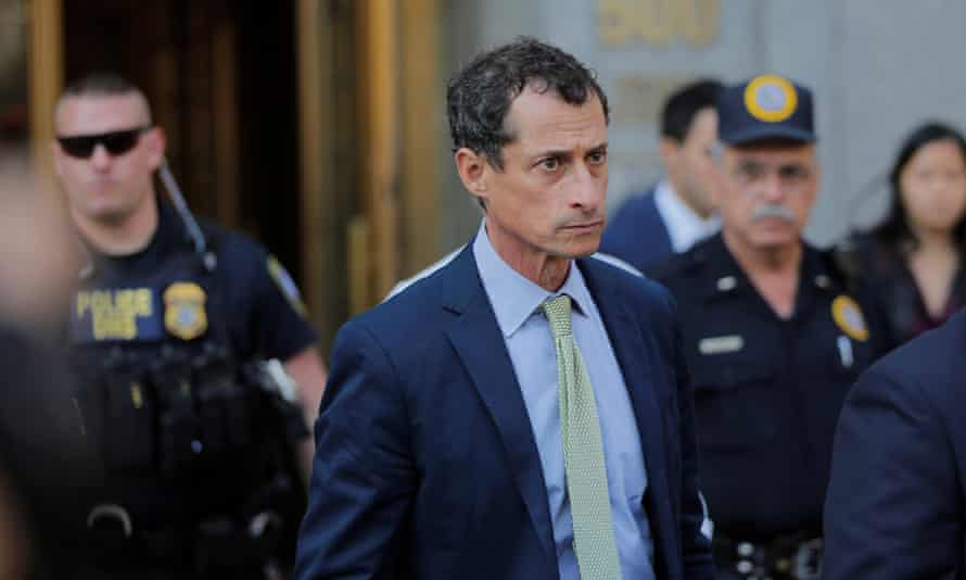 Anthony Weiner leaves court in Manhattan. As his sentence was announced, Weiner dropped his head into his hand and wept, then stared straight ahead.