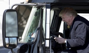 Donald Trump sits in the driver's seat of a semi-truck as he welcomes truckers and CEOs to the White House on 23 March 2017 to discuss healthcare