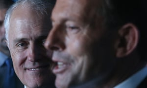 Malcolm Turnbull watches The Leader of the Opposition Tony Abbott at a press conference in 2013.