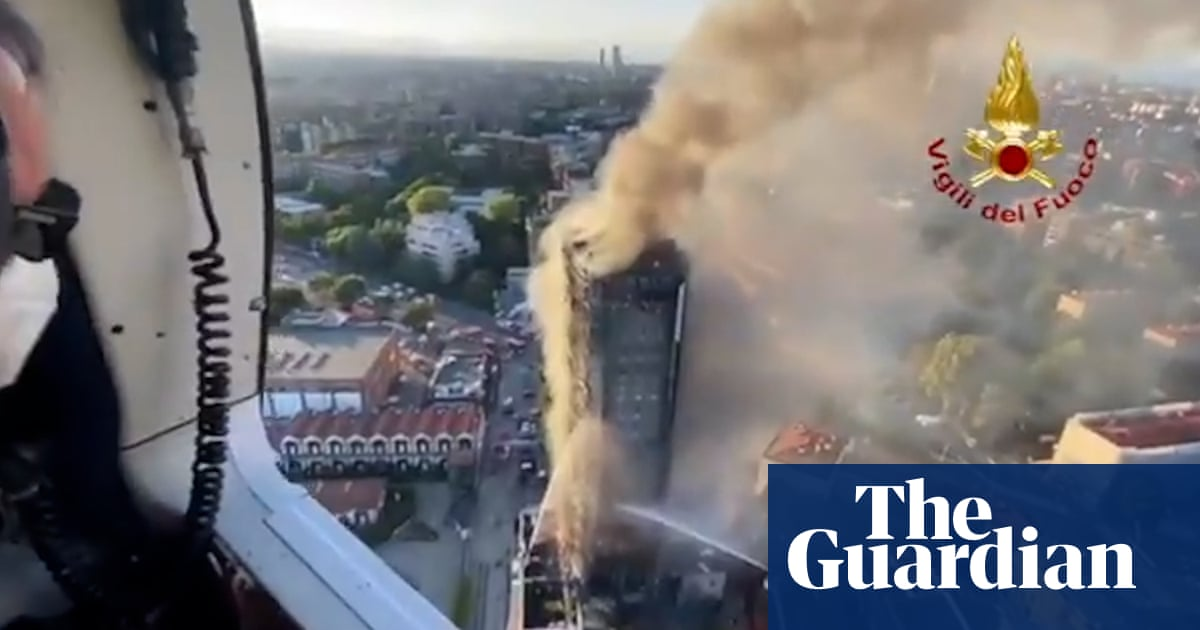 Flames engulf residential tower block in Milan – video