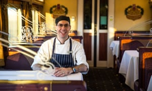 Indian Pacific Railway chef sits onboard in the Queen Adelaide restaurant car.