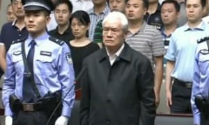 Chinese security chief Zhou Yongkang standing trial at the Intermediate People's Court in Tianjin.