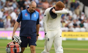 England's Jonny Bairstow (right) leaves the field in pain after damaging his left middle finger in the third Test against India.