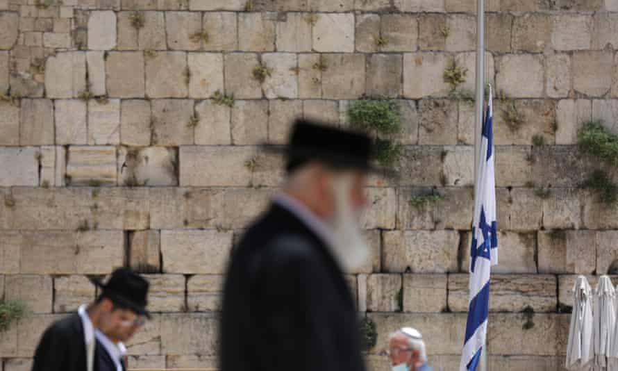 An Israeli flag lowered to half-mast in honour of the victims of the disaster