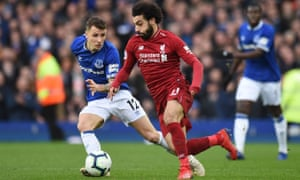 Everton's Lucas Digne vies with Liverpool's Mohamed Salah.