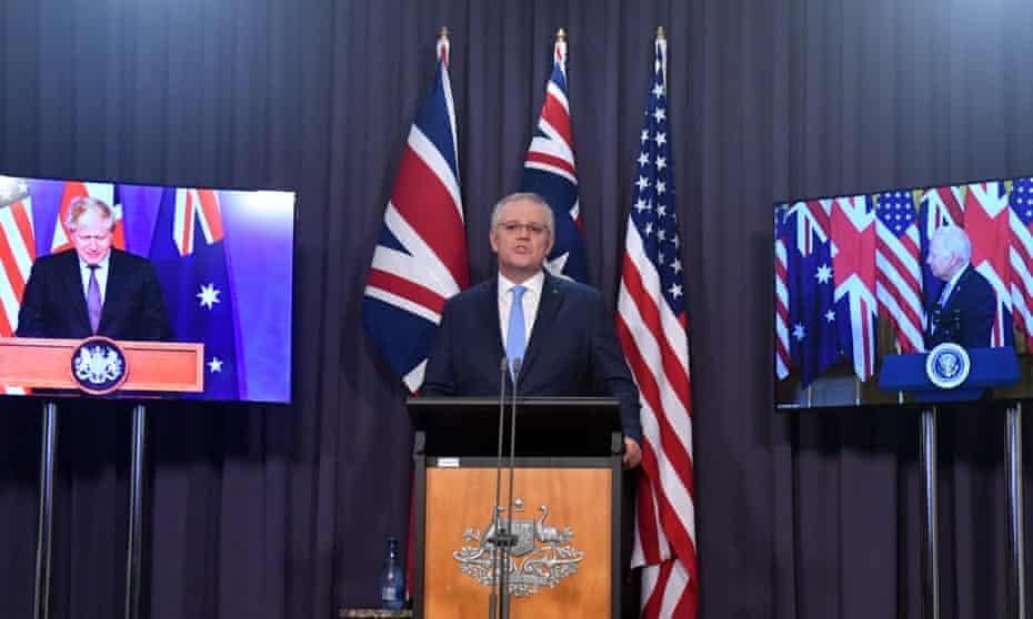 The UK prime minister, Boris Johnson (left), Australia's Scott Morrison (centre) and the US president, Joe Biden, at a joint press conference.