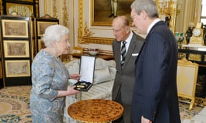 The Queen, Prince Philip and Australian High Commissioner Alexander Downer as she gave the prince the Insignia of a Knight of the Order of Australia, in the white drawing room at Windsor Castle.