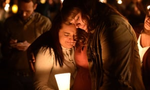 Mourners react during a vigil in Roseburg, Oregon on October 1, 2015, for ten people killed and seven others wounded in a shooting at a community college in the western US state of Oregon.