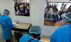 Health workers question passengers at La Aurora International Airport in Guatemala City after Guatemala reopened all its borders amid the COVID-19 novel coronavirus pandemic. Guatemala had closed its borders in March in an attempt to contain the disease that has so far hit the country with more than 84,344 cases and 3,076 deaths.