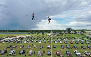 Sarasota, Florida, high wire artists Nik Wallenda (left) and Blake Wallenda perform at a drive-in stunt show at Nathan Benderson Park