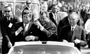 Willy Brandt, centre, then ruling mayor of West-Berlin, U.S. president John F. Kennedy, left, and German chancellor Konrad Adenauer, during sightseeing tour through Berlin, June 1963.