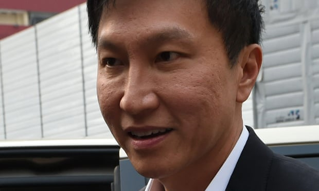 Kong Hee , the founder of City Harvest Church arrives at court in Singapore on Wednesday to face fraud charges.