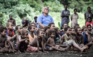 The village's children are transfixed.