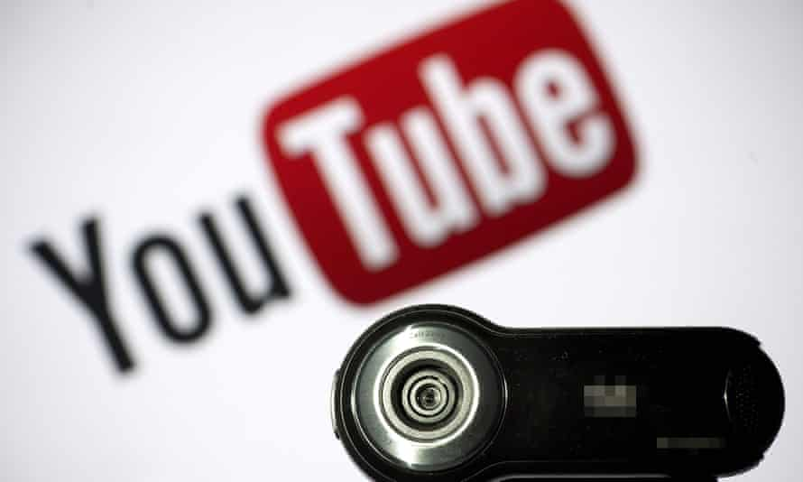 File photo of a webcam positioned in front of YouTube's logo