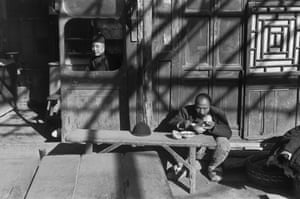 At the entrance to a tavern, Beijing, December 1948