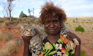 Pintupi woman Yukultji Napangarti displays a dead feral cat