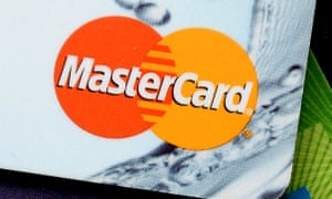A Mastercard on top of other credit cards