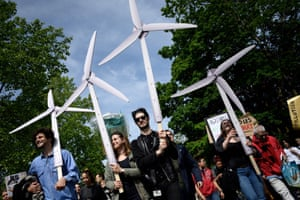 Protesters hold fake wind turbines