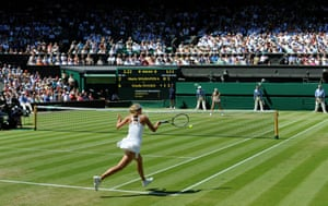 Maria Sharapova returns in her match with Giselle Dulko on Centre Court in 2009 Wimbledon