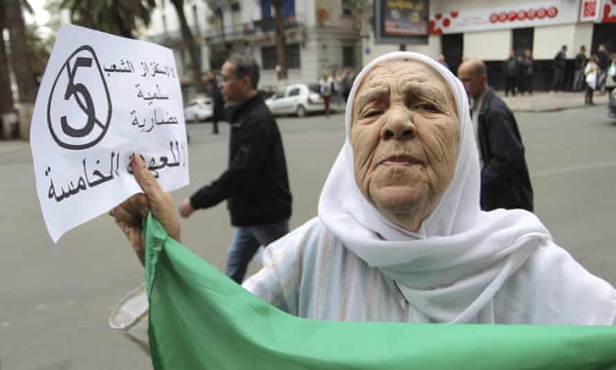 A woman demonstrates in Algiers.