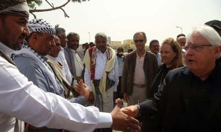 The UN special envoy for Yemen, Martin Griffiths, shakes hands with a Houthi-appointed local official in Hodeidah.